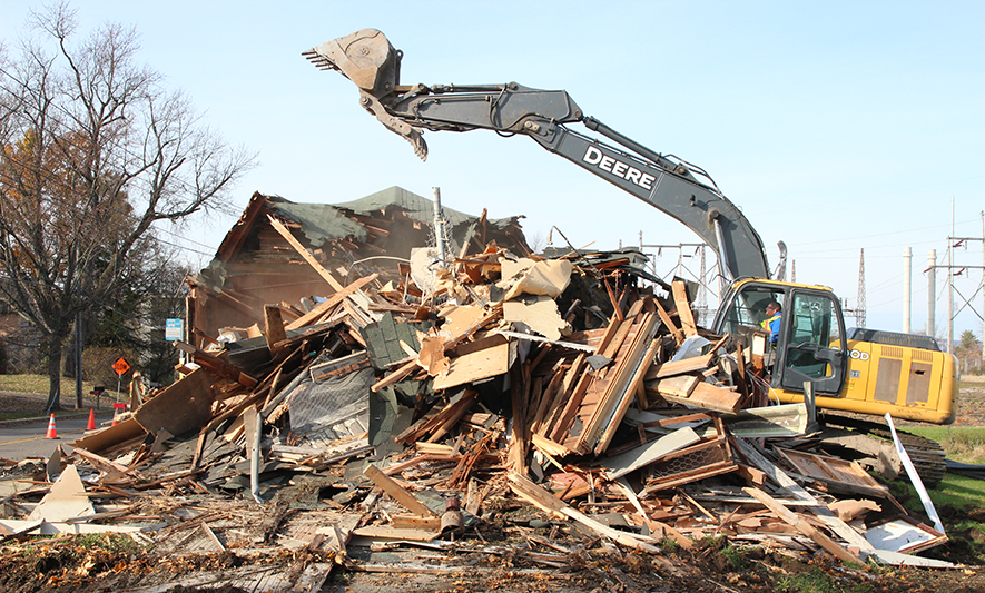 The Farm Services team demolishes an obsolete building
