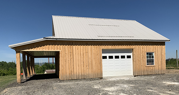 Outside of the Dilmun Hill barn with garage door
