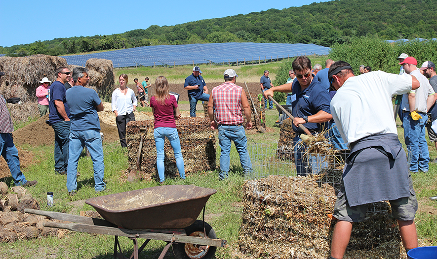 Participants from the compost facility operator class builds test piles
