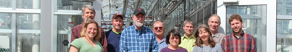 A few of our 50 CUAES staff in front of a greenhouse