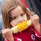 Girl eating sweet corn
